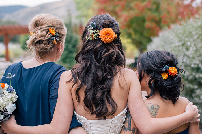 Bridal and bridesmaid hair with rustic flower details