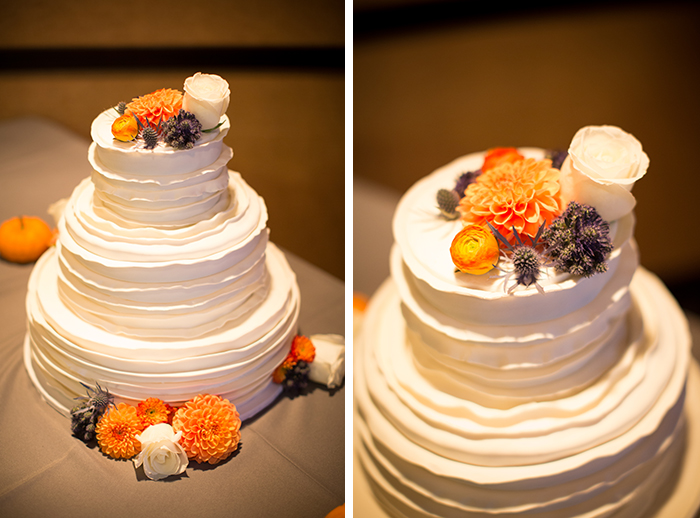 Rustic but simple blue and orange wedding cake