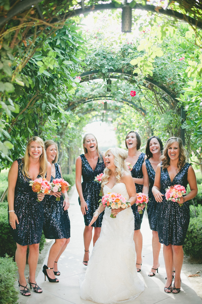 Bridesmaids in blue sequined dresses by Badgley Mischka