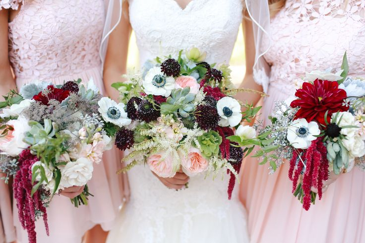 Dramatic red, brown and white wedding flowers