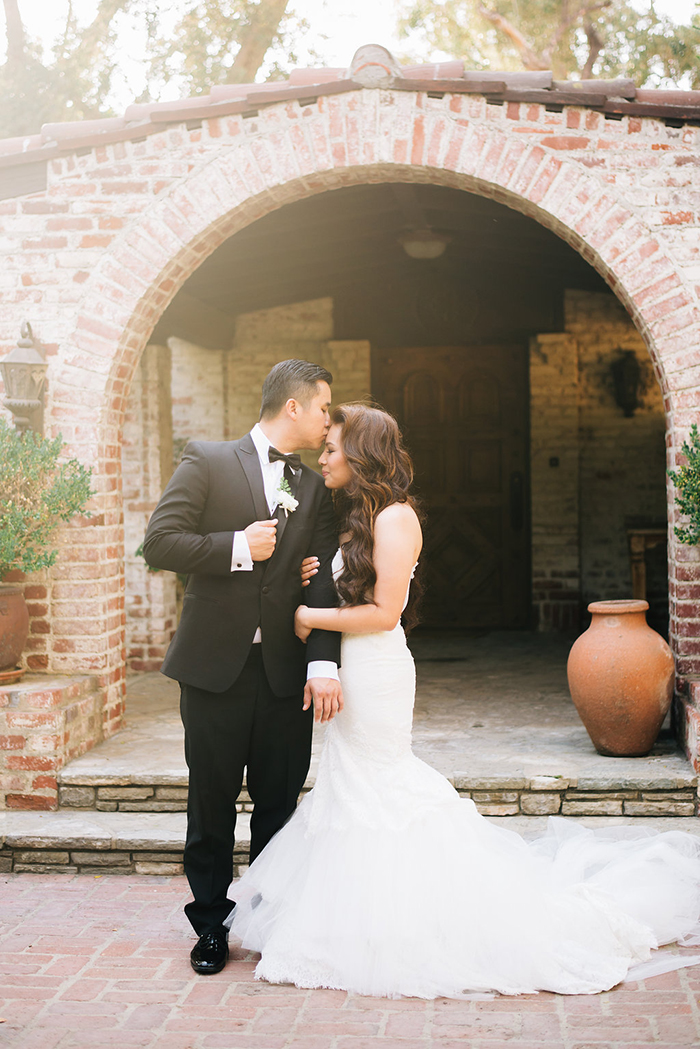 Sweet and romantic garden wedding photos of the bride and groom