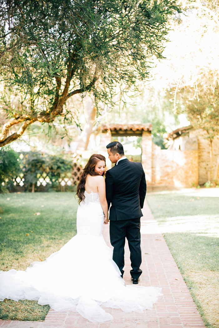 Gorgeous romantic garden wedding photo of the bride and groom