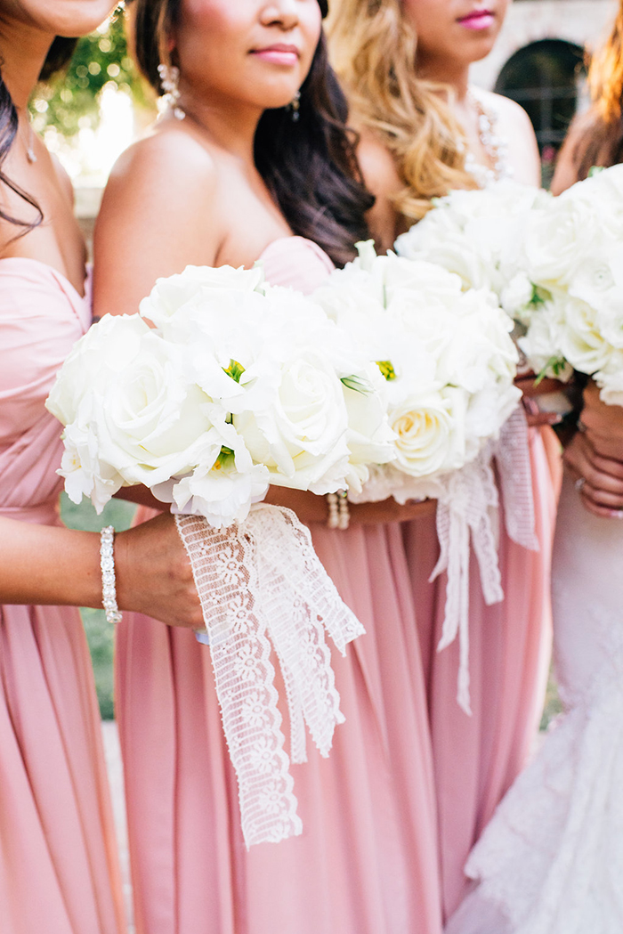 White bouquets with simple white ribbons