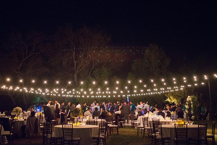 Stunning outdoor wedding ceremony lighting
