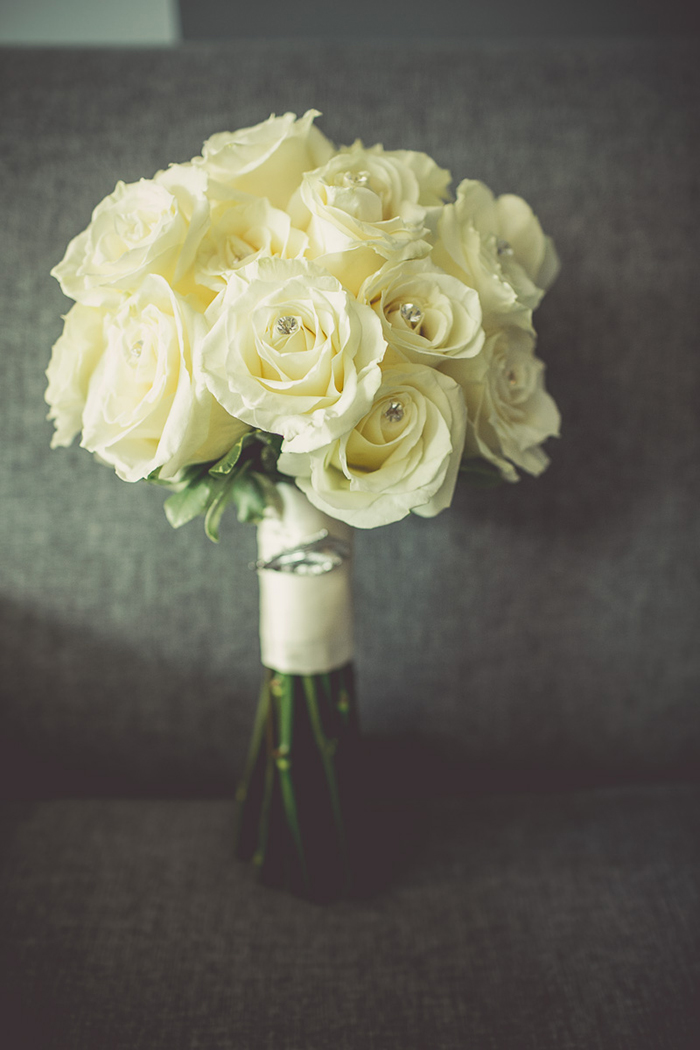 Classic white rose bouquet. So lovely!