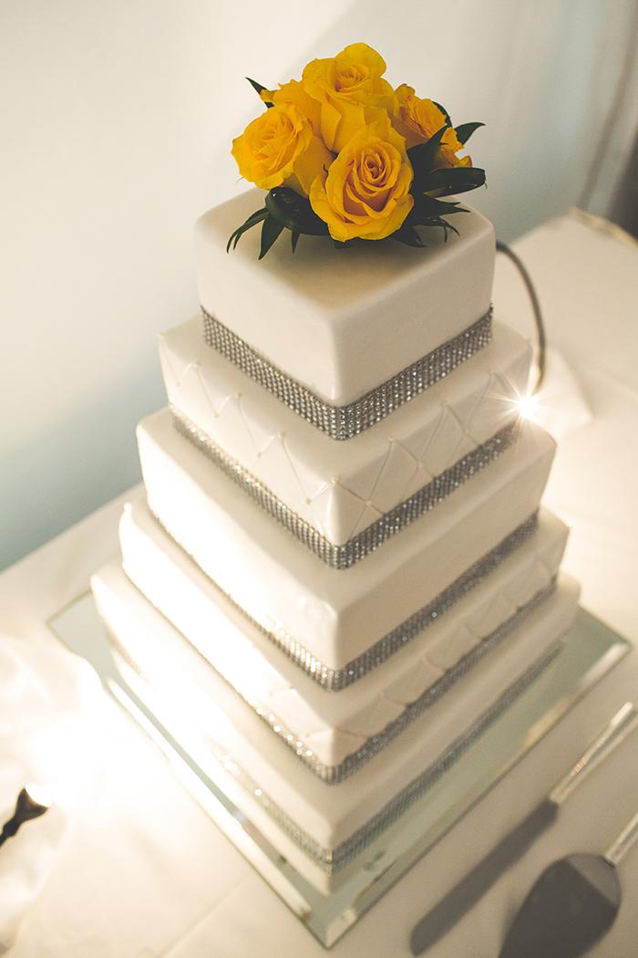 Elegant yellow and white wedding cake
