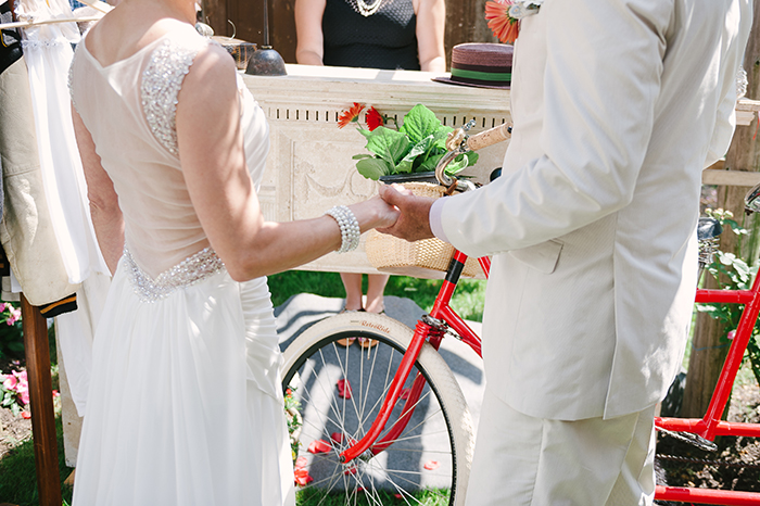 Rustic red outdoor wedding ceremony with a tandem bike!