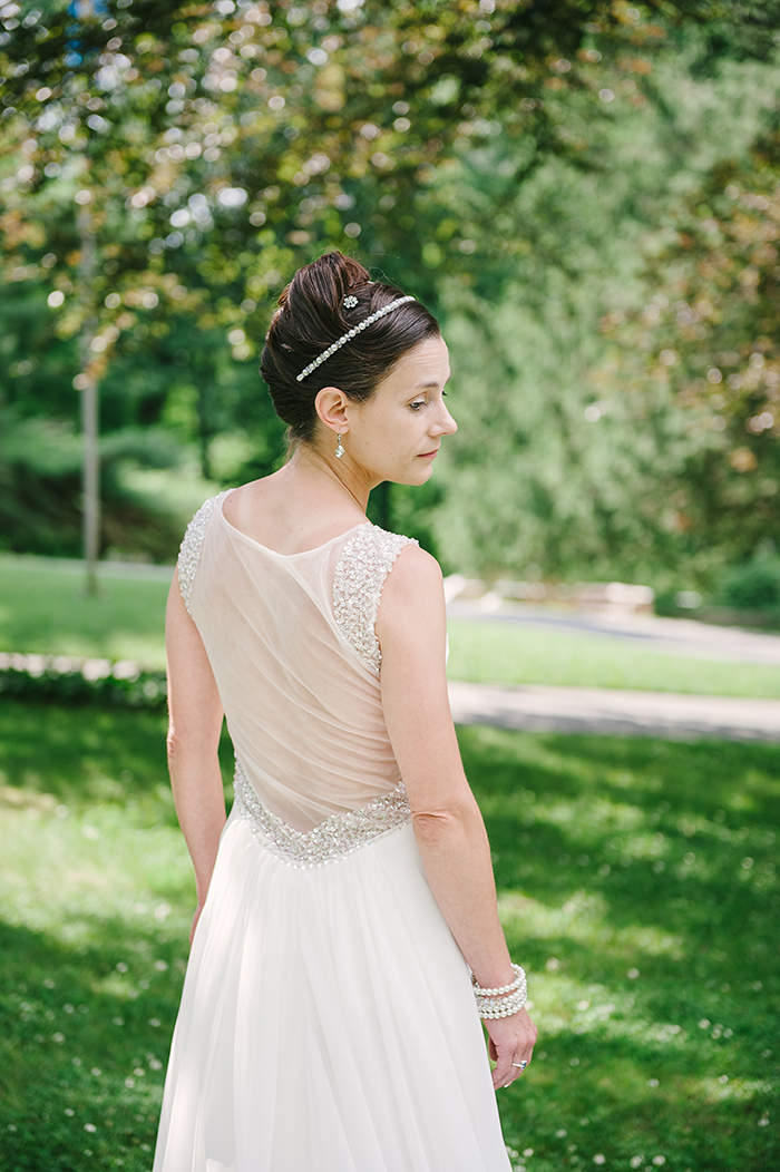 Lovely bride with a sheer back wedding dress