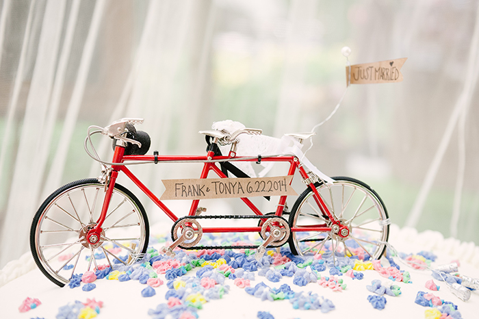Cute tandem bike wedding cake topper
