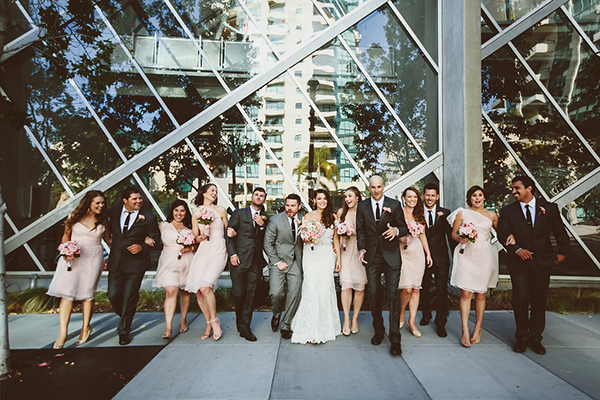 Great photo of the bride groom and their bridal party!