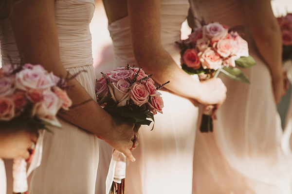 Bridesmaids in pink with pink rose bouquets
