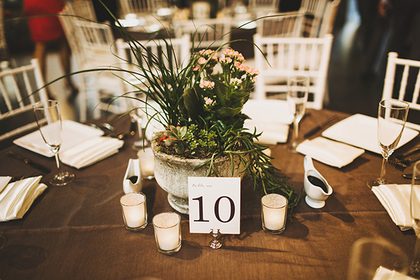 Wedding reception centerpiece idea that is a little offbeat and doesn't require expensive flowers!