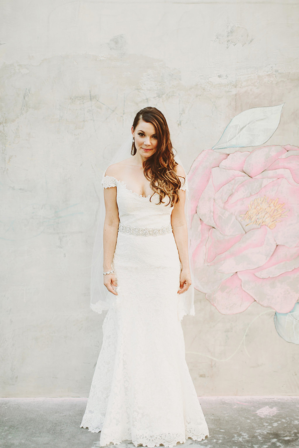 Adorable and glam photo of the bride. Love her lace off shoulder wedding dress!