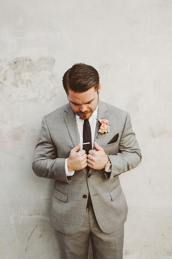 Groom attire: a gray suit, black tie and pink boutonniere. Perfect!