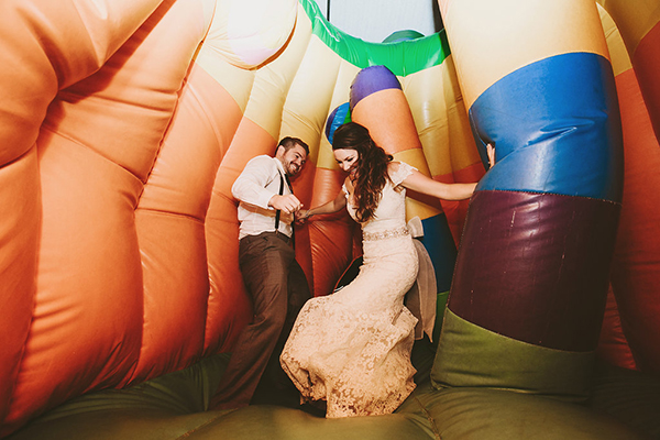 A bride and groom in a bouncy castle! this idea is the best!