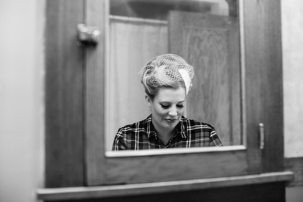 Bride getting ready on her wedding day-- by First Comes Love Photography