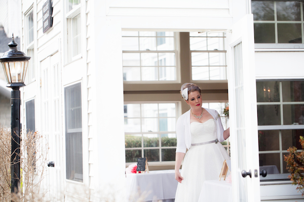 Soon to be married bride peeking out the door before heading down the aisle!