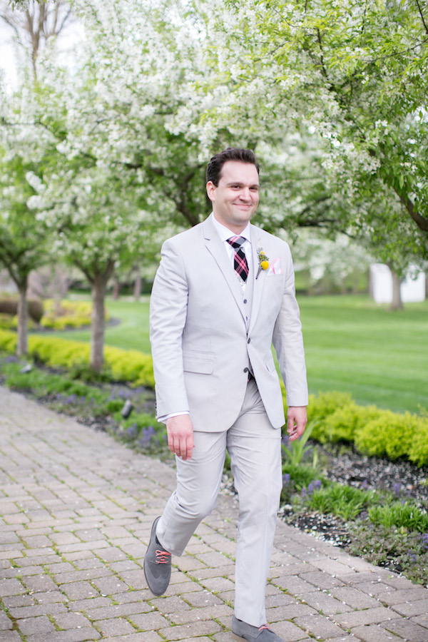 Adorable groom walking down the aisle on his wedding day!