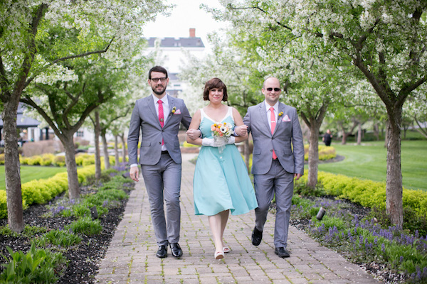 MIsmatched number of bridal party members? Have two groomsmen walk one bridesmaid down the aisle!