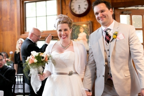 Beautiful bride and groom entering their reception!