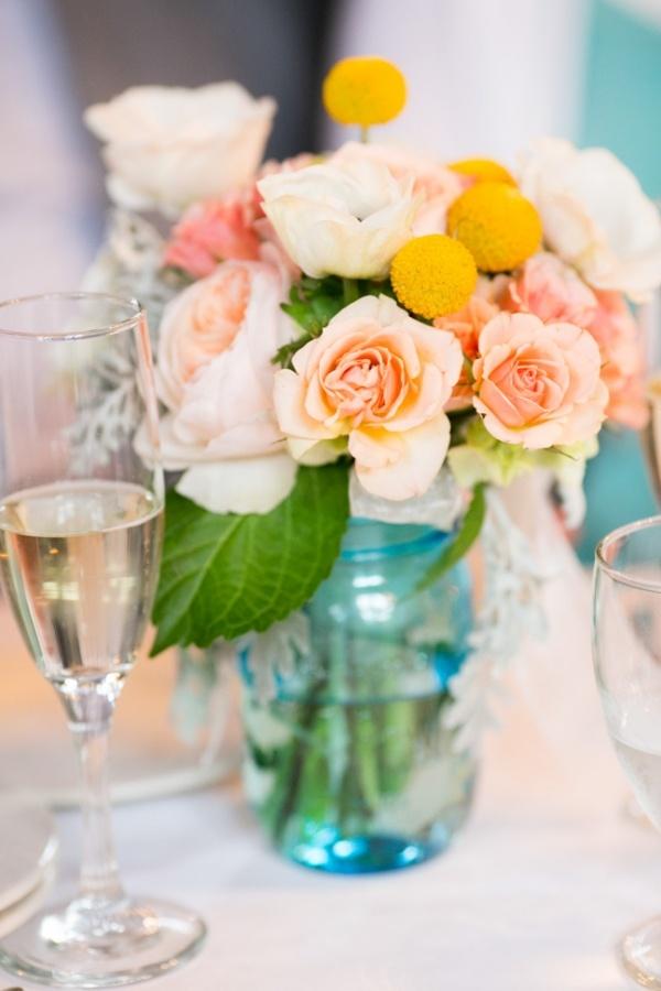 Love peach and yellow centerpieces for a garden party wedding!
