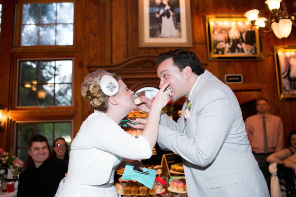 Cupcake sharing at this very fun garden party wedding!