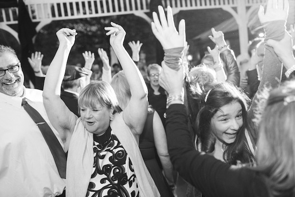 Guests having a blast at a 50's vintage garden party themed wedding!