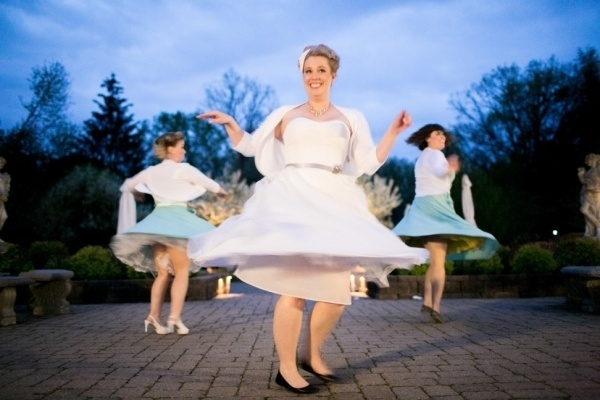 Bride with her bridesmaids twirling and dancing the night away!