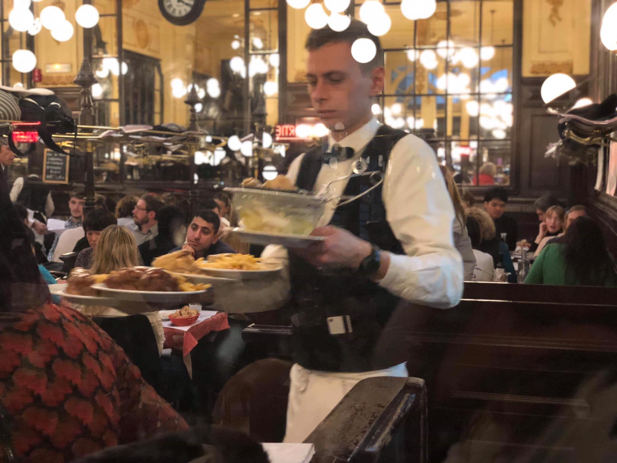 Go to the Bouillon Chartier on Rue du Faubourg Montmartre, a brasserie founded in 1896. The ambience is incredible in this 300 hundred seat restaurant that is open 365 days a year. You absolutely need to go there, right after the Eiffel Tower! -