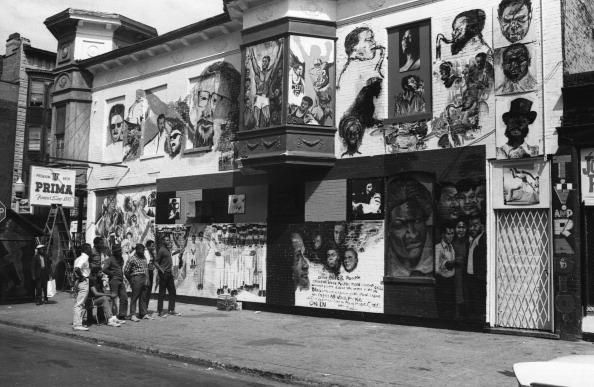Community members admire  the wall of respect  in chicago, 1967.