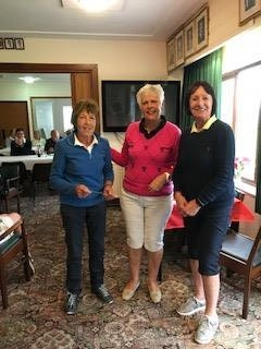 Cheryl Hamer of St. Idloes (L), Margaret Bowen, MWCGA Vice-Captain and Gail Beaurain, St. Idloes Club Chairman