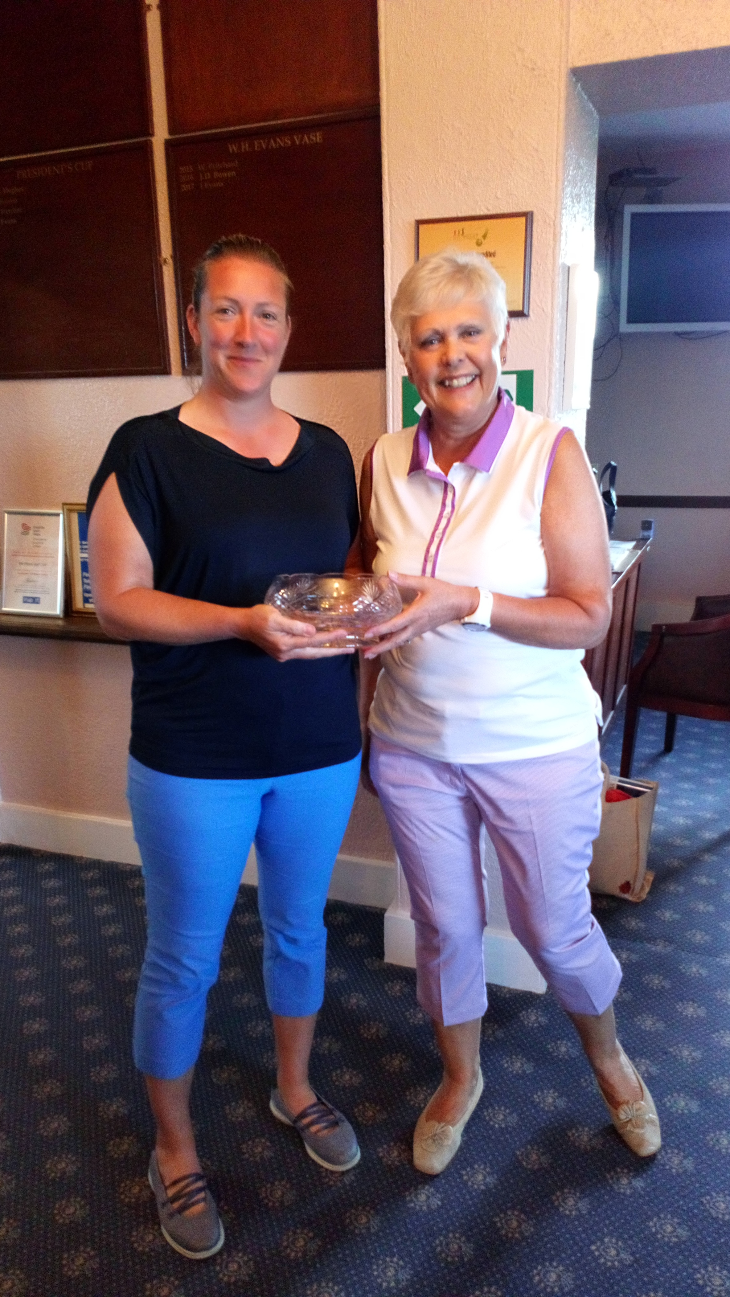 Ellen Jones of Welshpool receiving, somewhat appropriately, the Welshpool Crystal from Margaret Bowen, MWCGA Vice-Captain. Ellen also won the longest drive kindly given by Welshpool GC.