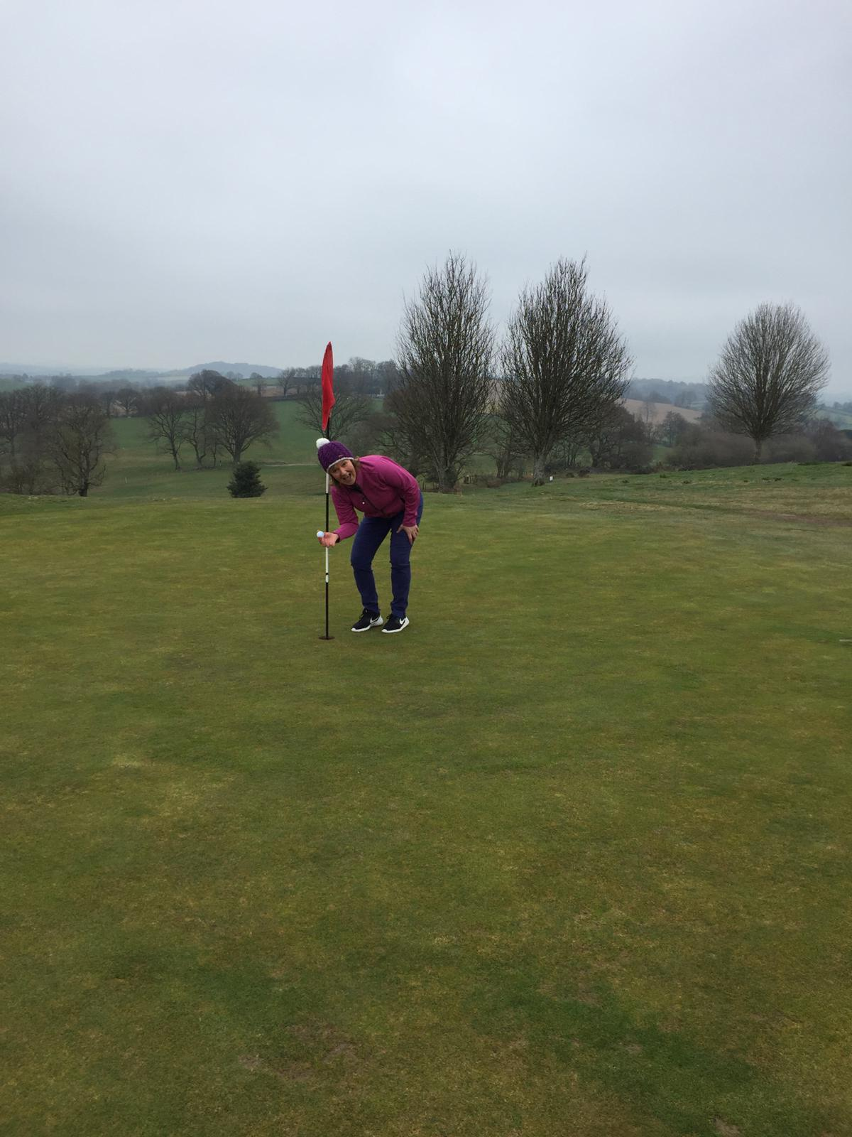 A very happy Hayley Price retrieves her ball from the hole on the 3rd.