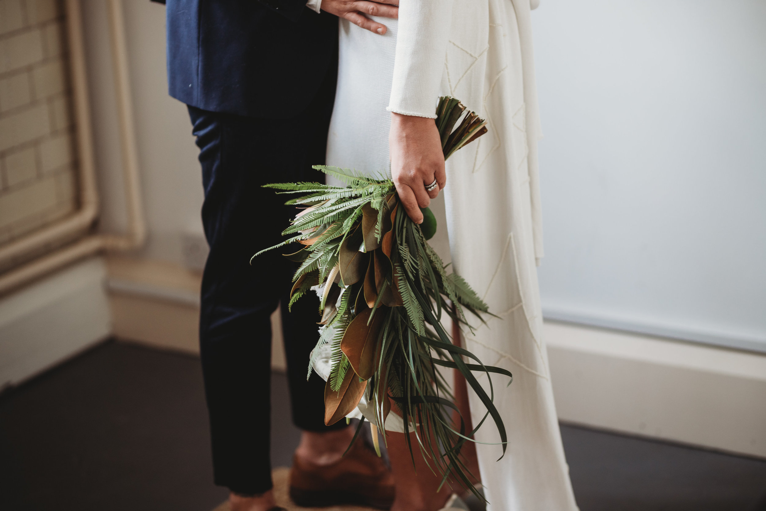 Magnolia and Protea presentation wedding bouquet