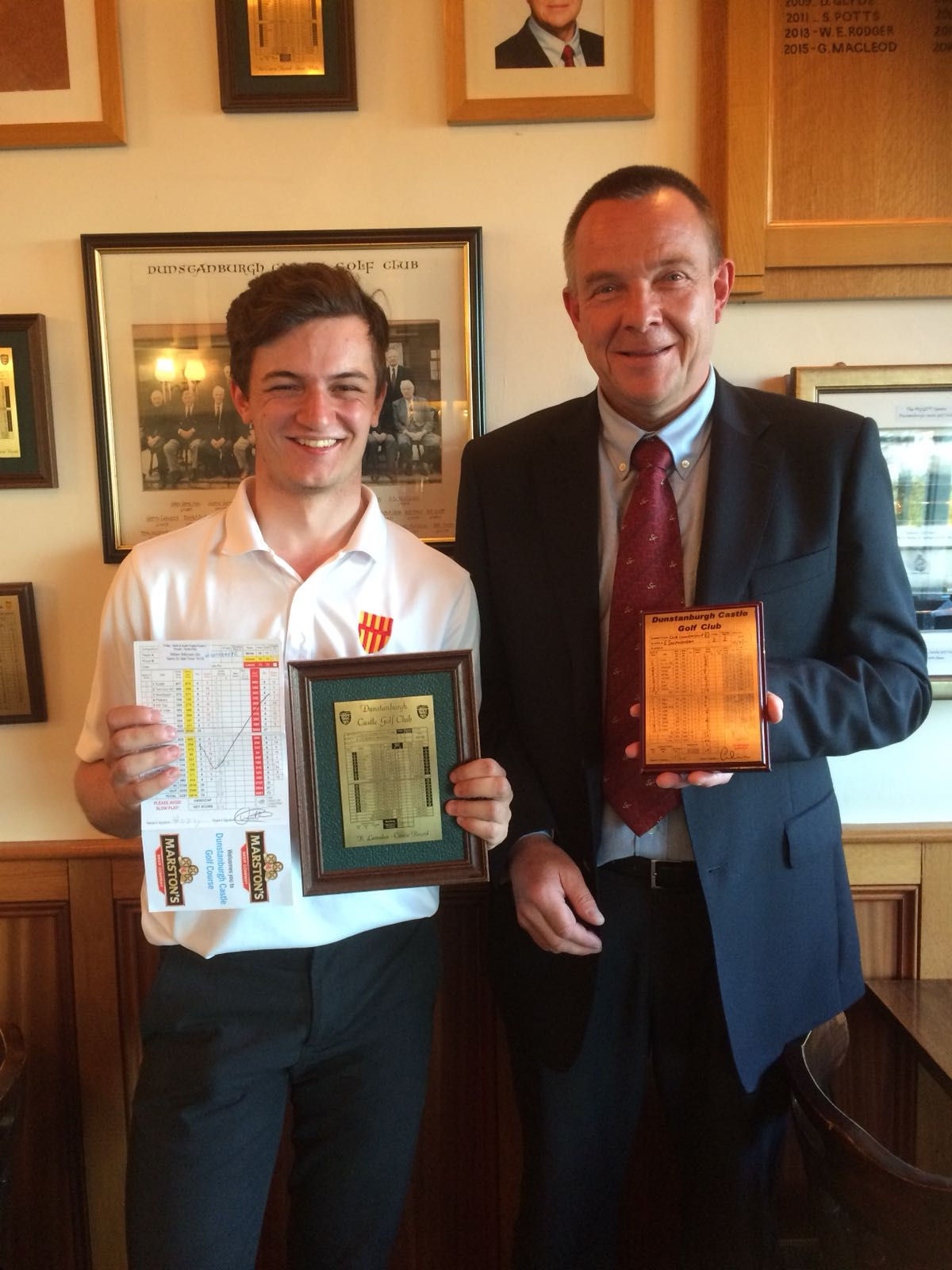 William Wilkinson getting the best of conditions this summer. Here is a picture of him and captain Kieth Wilson after shooting a course record equal 64 in the North and South Trophy back in May