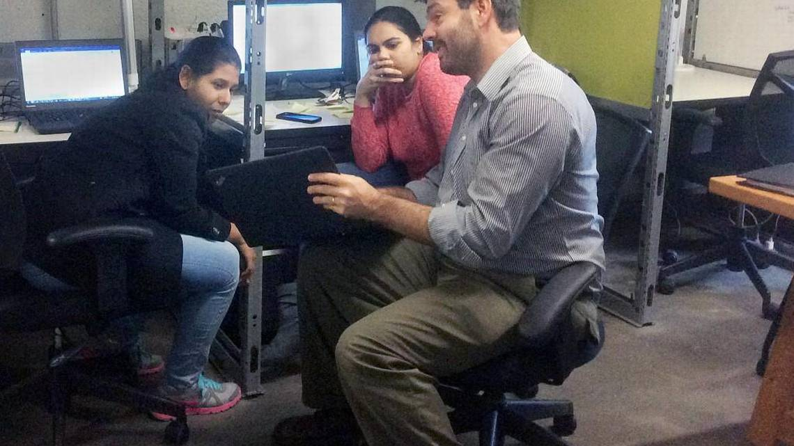 From right, Quantworks co-founder Anthony Volpe talks about an analytics project with system administrators Juhi Desai and Swathi Katta on Tuesday, Nov. 29, 2016, on the second floor of Launch Chapel Hill at 321 W. Rosemary St. in Chapel Hill, NC.  TAMMY GRUBB   TGRUBB@NEWSOBSERVER.COM