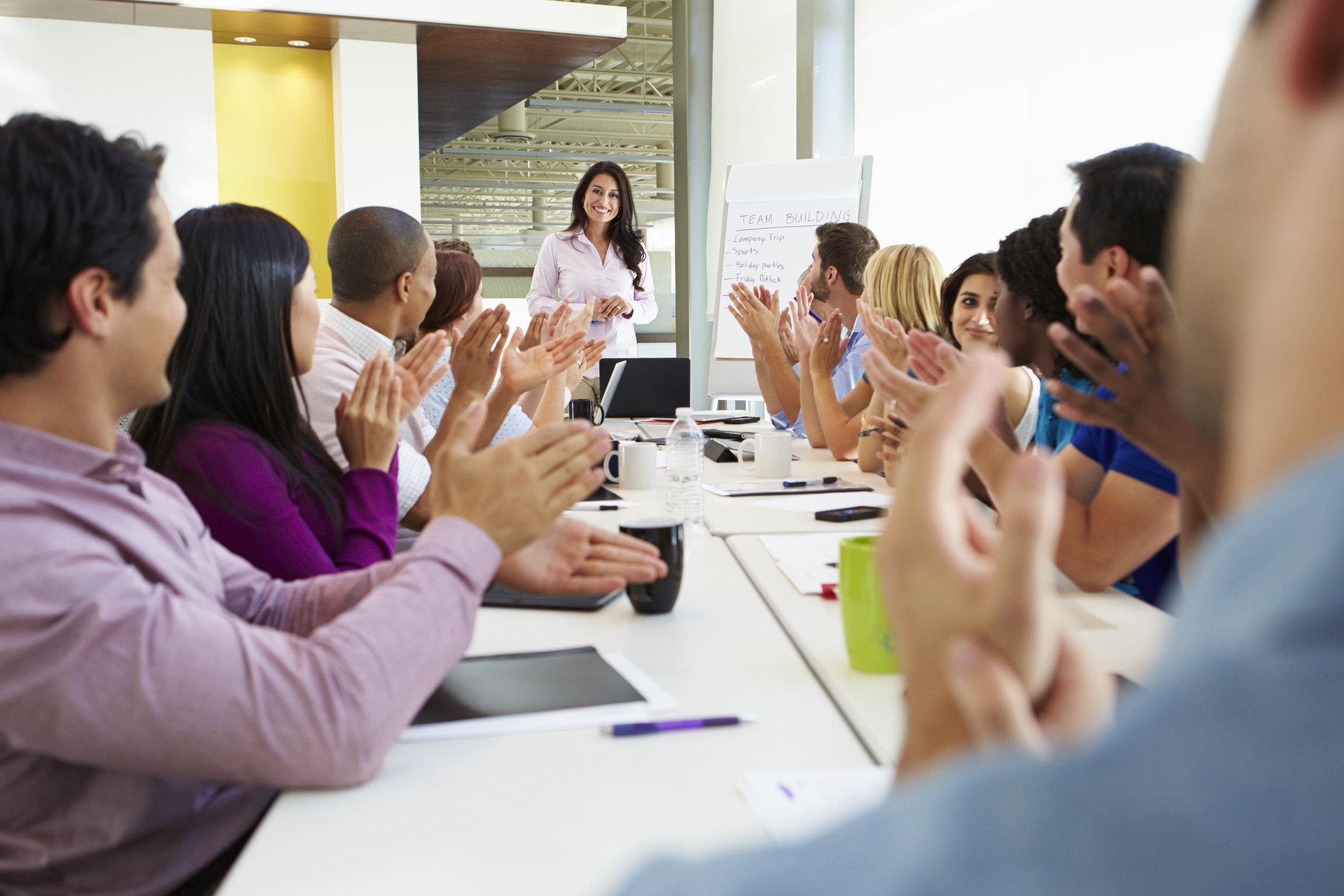 businesswoman-addressing-meeting-around-boardroom-P7EDZZT.jpg