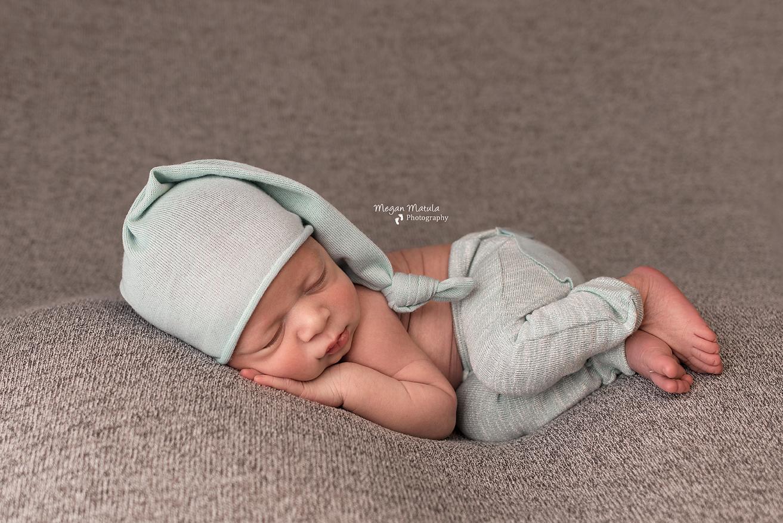 newborn sleeping on side