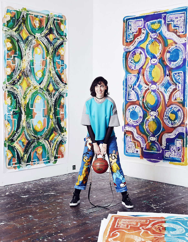 Studio portrait with silk paintings