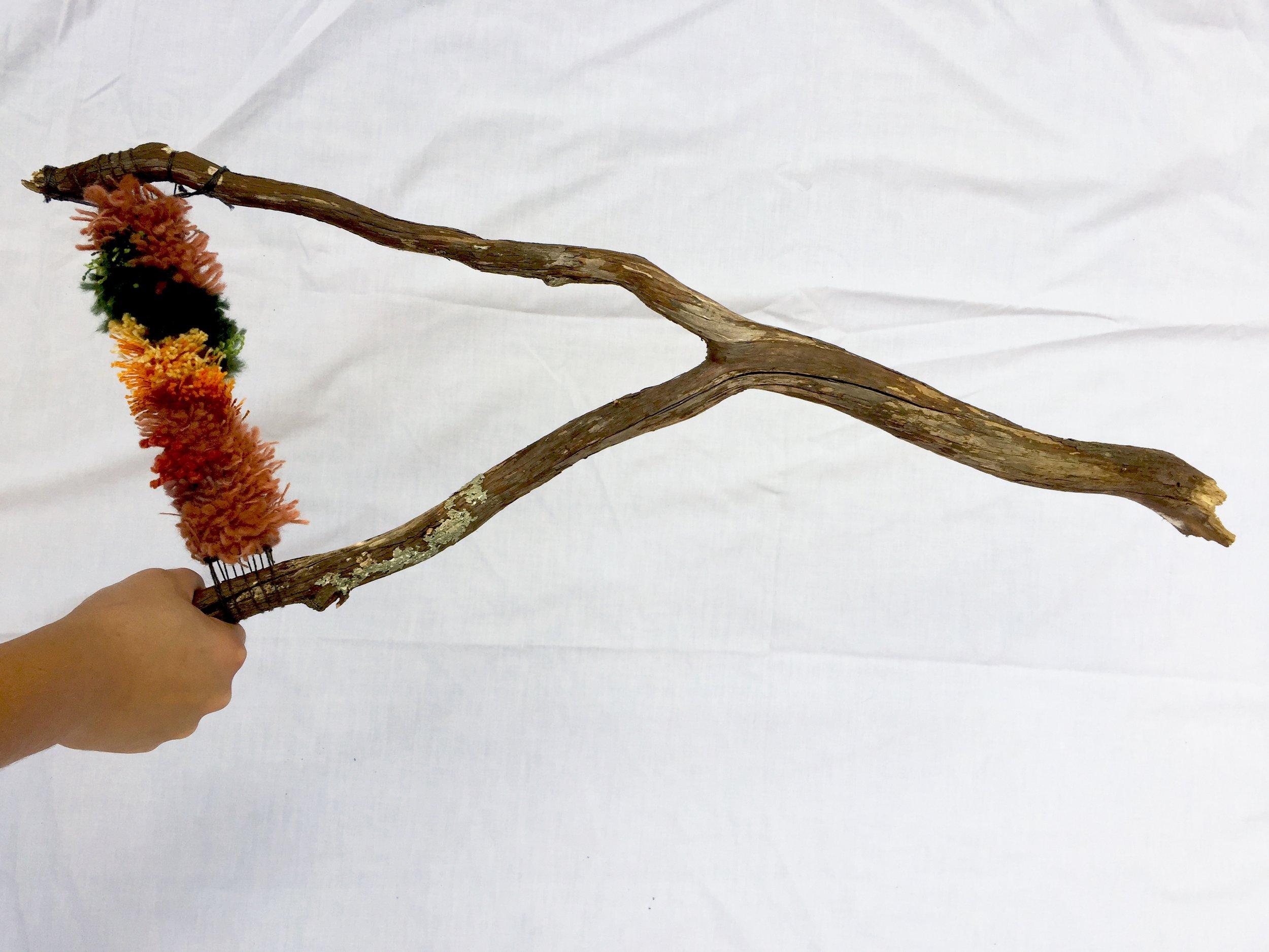 Dowsing Rod, 2017. Wood, various handspun and commercial yarns.