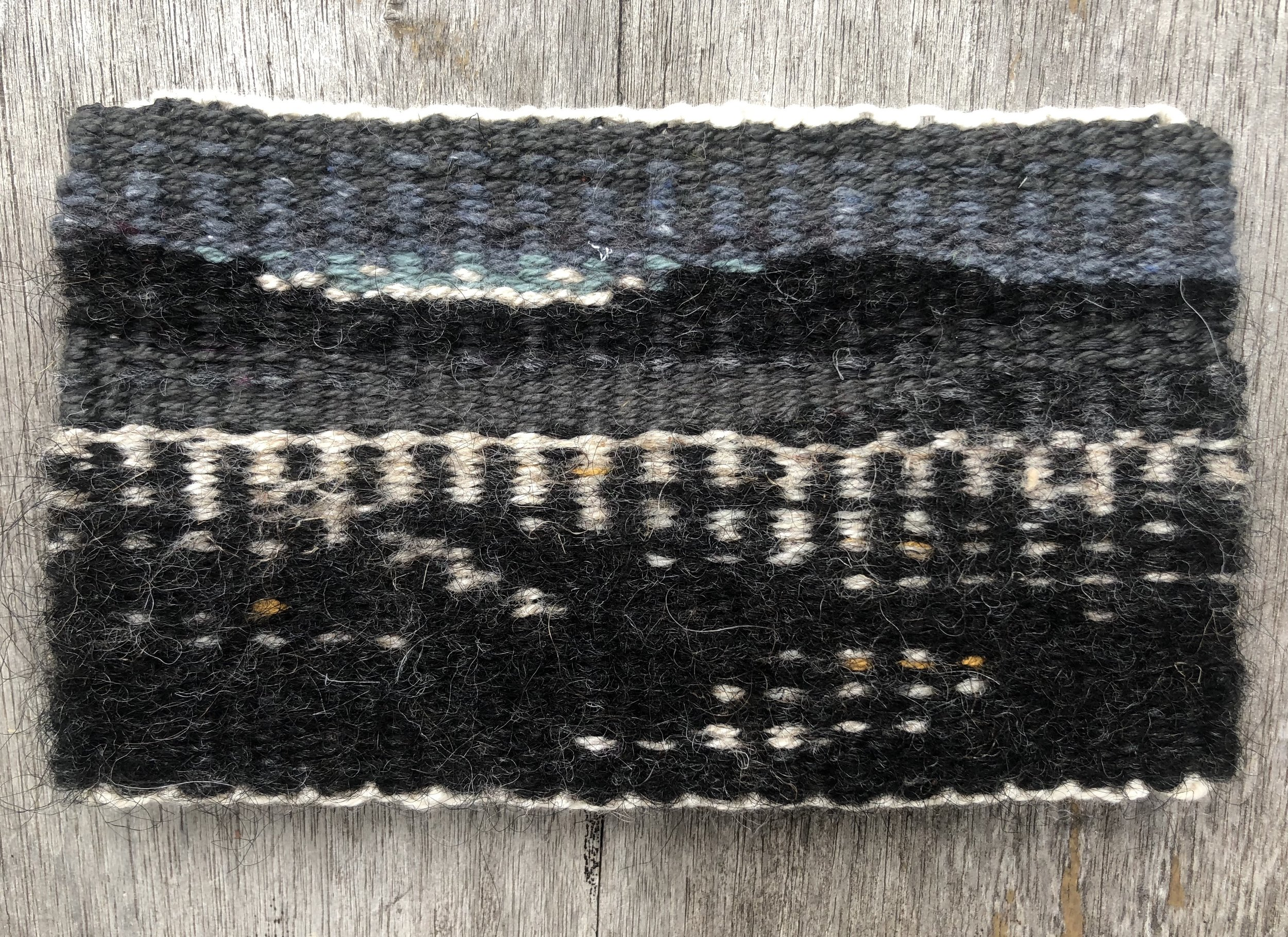 """City of Angels, 2018. Linen, wool, and cotton. 3 1/2"""" x 6""""."""