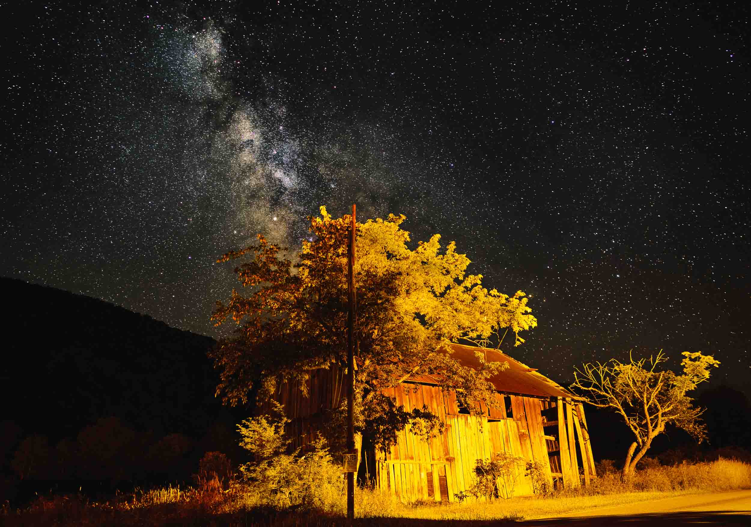 An illuminated barn stands under the Milky Way in Cherry Springs State Park in northern central Pennsylvania.