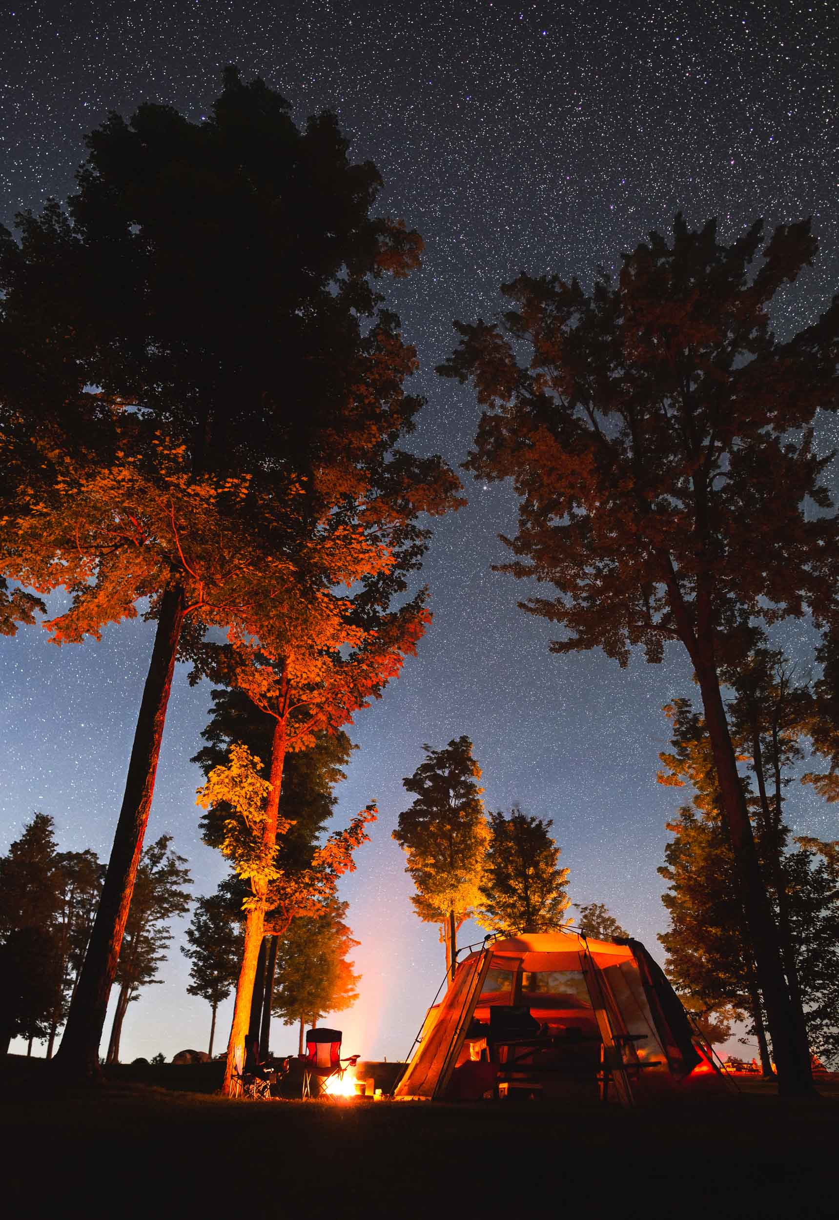 A family camps under a star-dotted sky at Cherry Springs State Park in northern central Pennsylvania, an official Dark Sky site where stars, planets and the Milky Way are easily visible. It is one of the few such places on the East Coast.