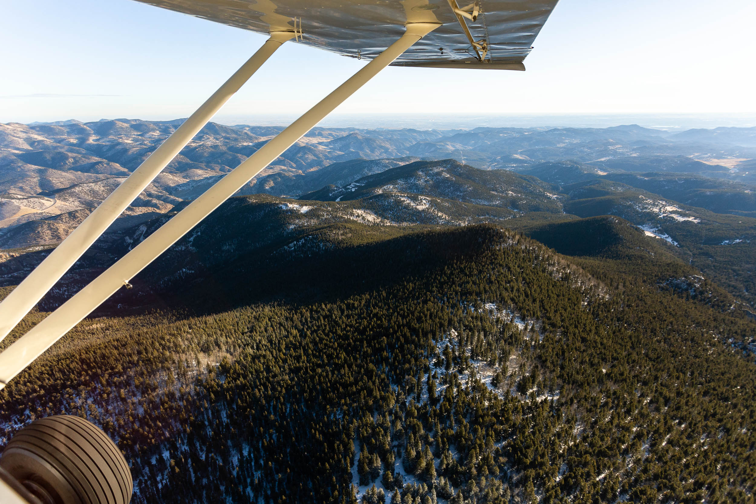 An aerial photograph out of an airplane of the Foothills of the Rocky Mountains near Boulder, Colorado.