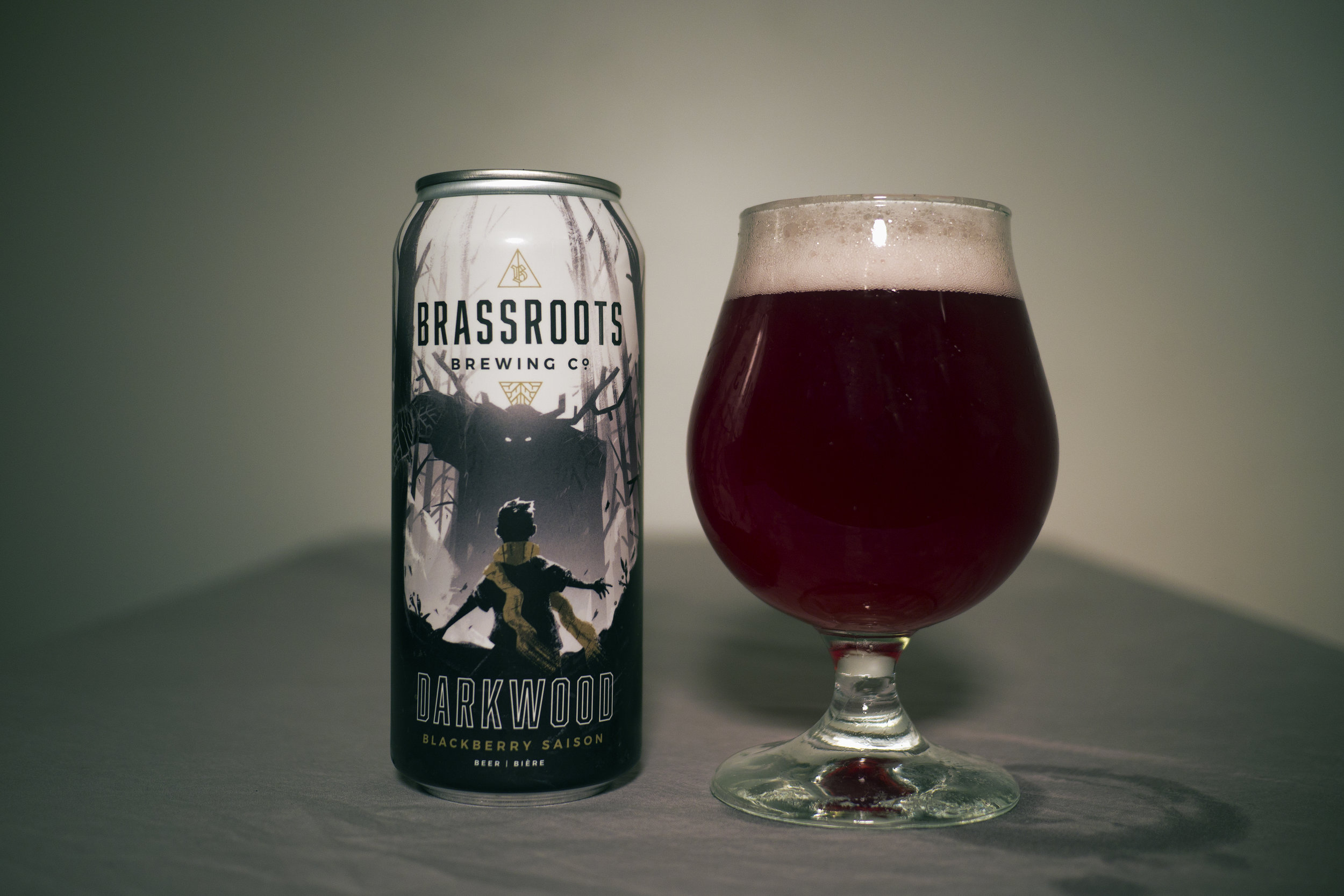 Darkwood Blackberry Saison The first of many beers that's dedicated to adding something new to the Ontario craft beer network.Darkwood has the characteristics of a classic Belgian Saison (fruity,spicy)with the addition of an understated fruited tartness.450 lbs. of blackberry puree,shipped in from Oregon, was added to this Saison.The blackberries give Darkwood a beautifully unique reddish hue and is rounded out by a mild aromatic bitterness imparted by three citrus forward hops:Amarillo, Simcoe and Mosaic.At 4.3% abv. Darkwood maintains a full body while remaining sessionable. Suited perfectly on a hot sunny day.     -