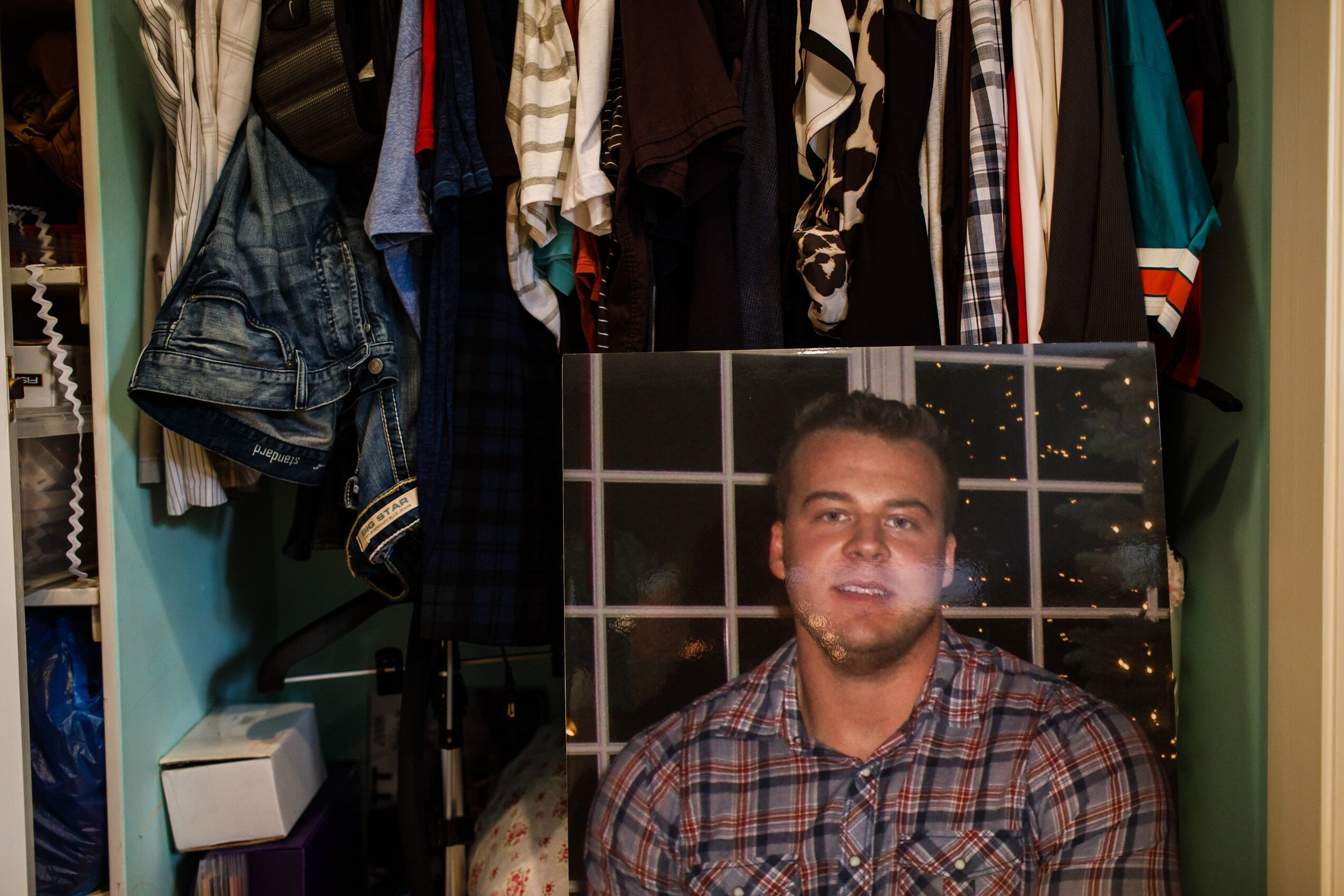 Picture of Spencer in front of his clothes and other belongings.    CREDIT: LEAH NASH FOR FINDING FIXES »