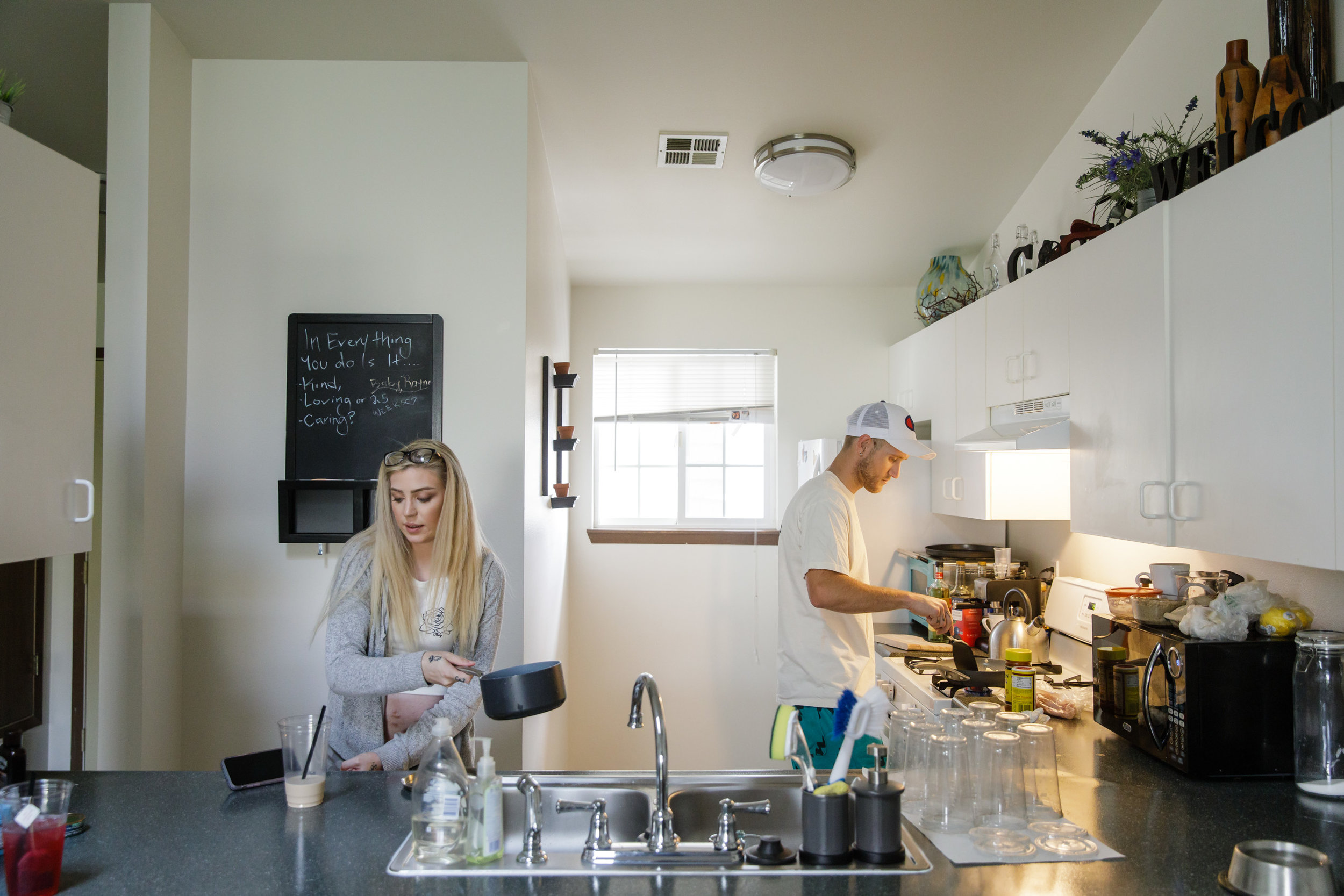 Hallie Martin and Monty McGary in the kitchen of their new apartment.    CREDIT: LEAH NASH FOR FINDING FIXES »