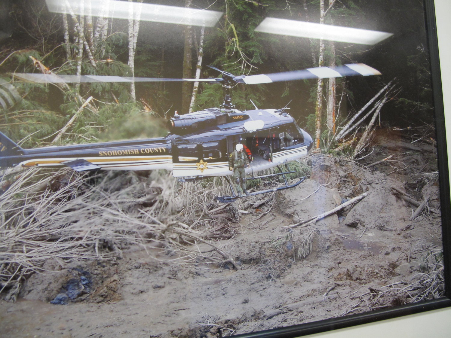 A photo at the Snohomish County Sheriff's office of a helicopter with emergency responders at the site of the 2014 Oso mudslide.   CREDIT: ANNA BOIKO-WEYRAUCH»