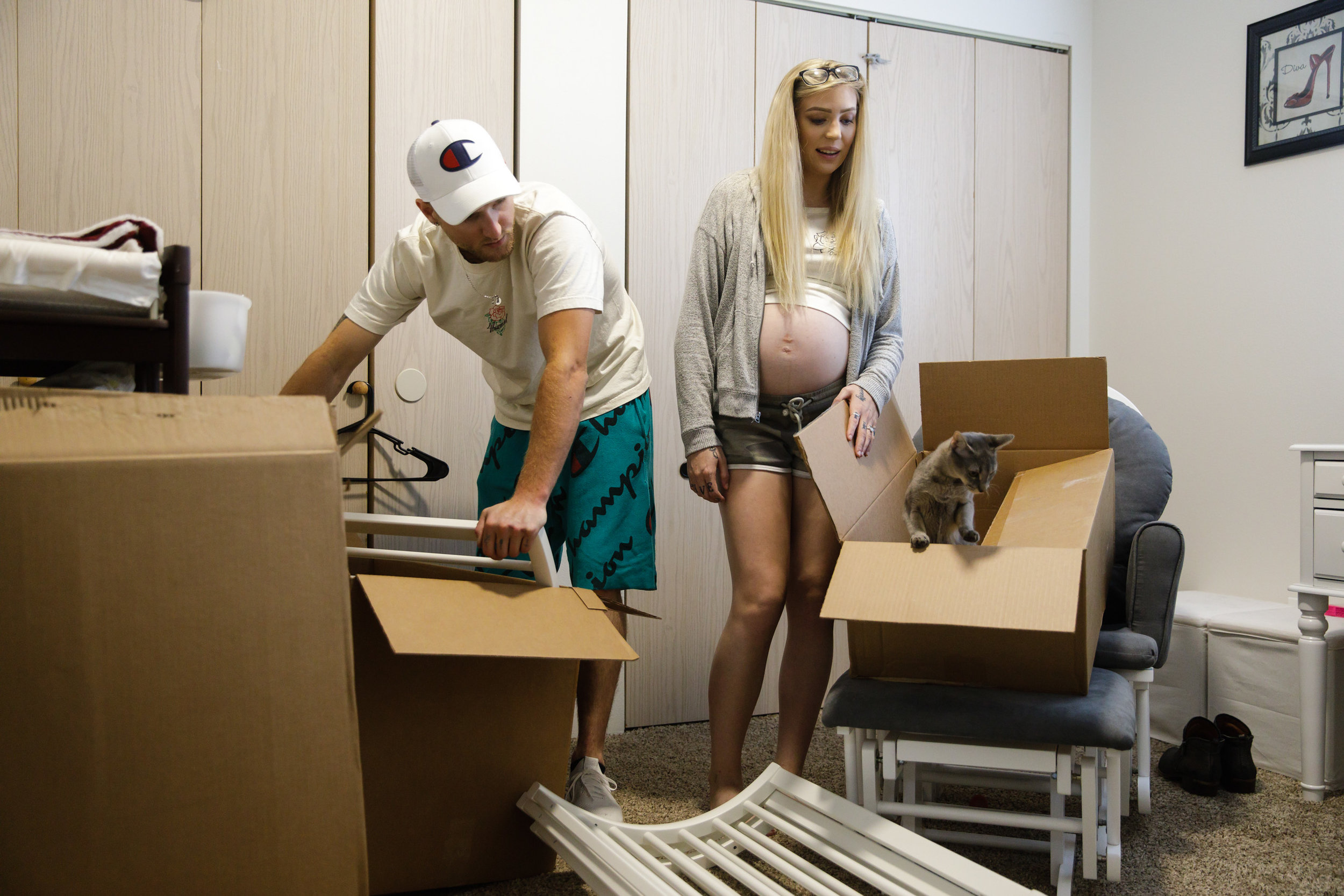 Hallie Martin and Monty McGary setting up a nursery in their home.   CREDIT: LEAH NASH FOR FINDING FIXES »
