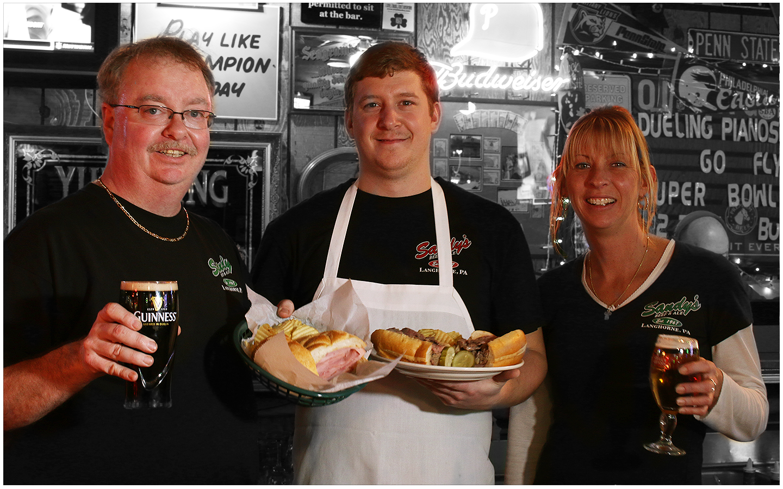 Owner Dave Guindon (far left), Mark (Manager) and Tracy (Bartender).
